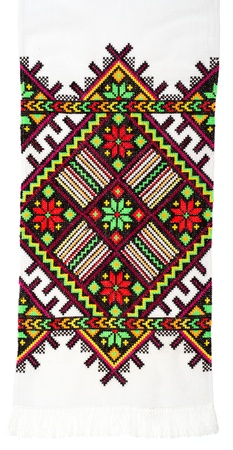 embroidered handmade good by cross-stitch pattern. ethnic colorful pattern photo