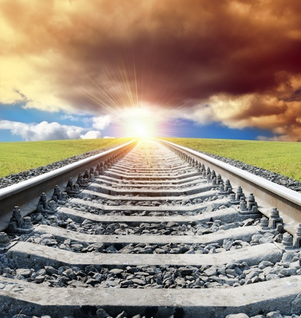 rail goes to sun in dramatic sky Stock Photo - 9340045