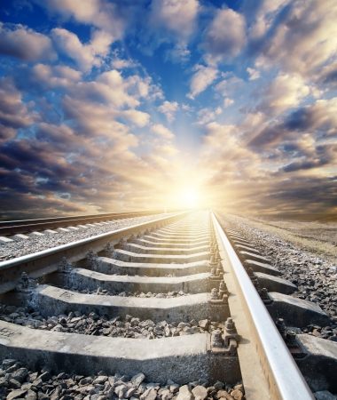 rail roads: railway to sunny horizon Stock Photo