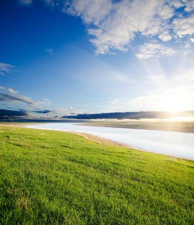 farmlands: sunset over river