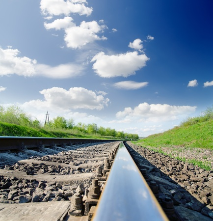 low angle view of railway under cloudy sky photo
