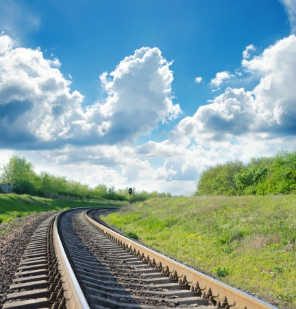 railroad track: railway goes to horizon in green landscape