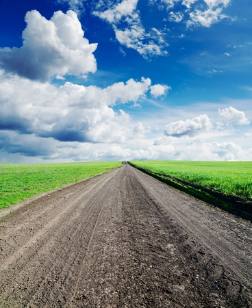 rural road in green grass and cloudy sky Stock Photo - 9589617