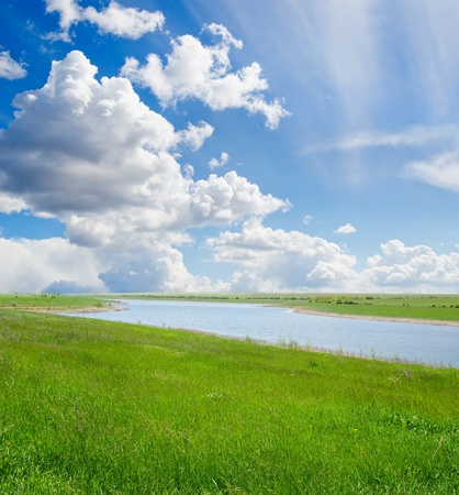 green grass and cloudy sky with river Stock Photo - 9623451