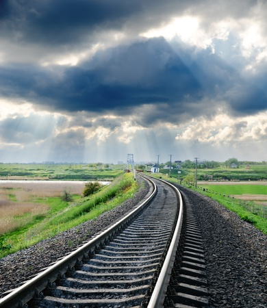 railroad to horizon under cloudy sky Stock Photo - 10043354