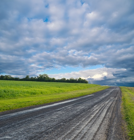 rural road and stormy clouds Stock Photo