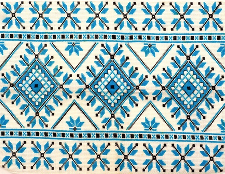 embroidered good by cross-stitch pattern. ukrainian ethnic ornament photo