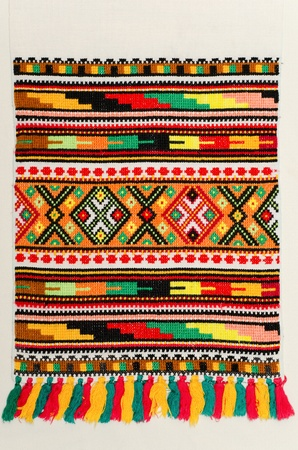 cross stitch: embroidered good by cross-stitch pattern. ukrainian ethnic ornament