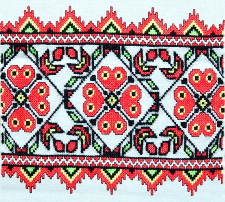 motive: embroidered good by cross-stitch pattern. ukrainian ethnic ornament