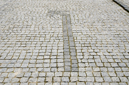cobbled road with arrow to left photo