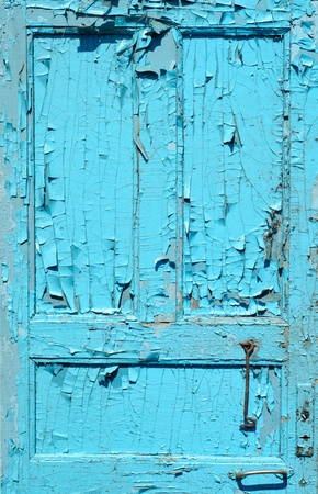 cracked old painted blue door photo