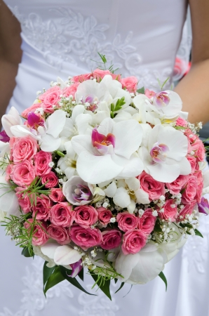 Bride with wedding bouquet photo