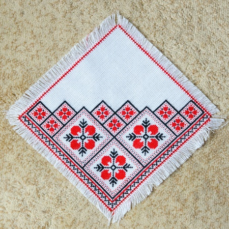 serviette: embroidered good by cross-stitch pattern. ukrainian ethnic ornament