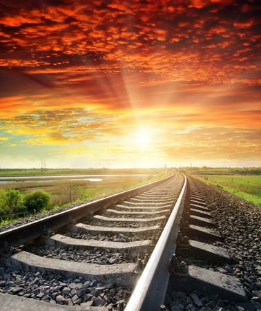 railroad to red sunset photo