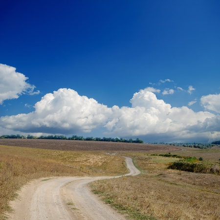 rural road under dramatic cloudy sky photo