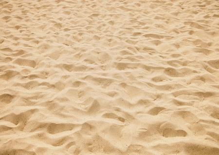 la texture du sable jaune sur la plage