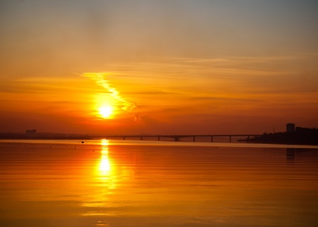 sunset over river photo