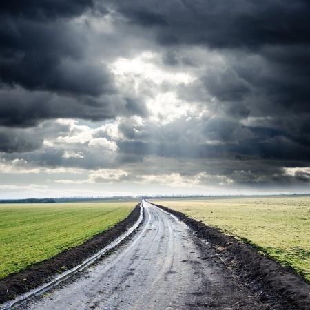 overcast: dirty road to cloudy horizon. rain before