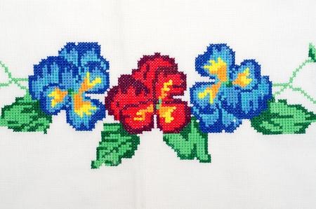 knit stitch: embroidered good by cross-stitch pattern. ukrainian ethnic ornament