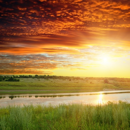 golden sunset over river photo