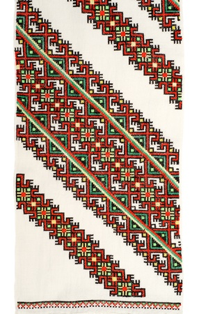 embroidered good by cross-stitch pattern  ukrainian ethnic ornament photo