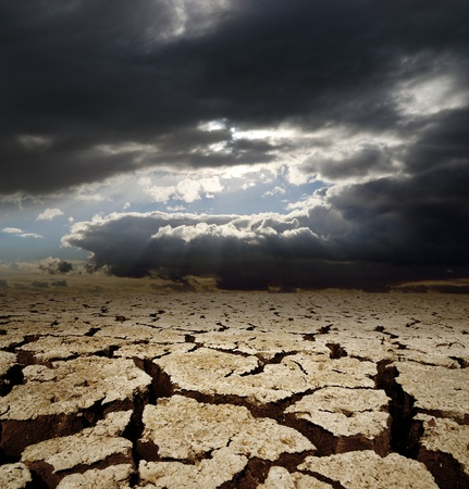 dramatic sky and drought earth photo