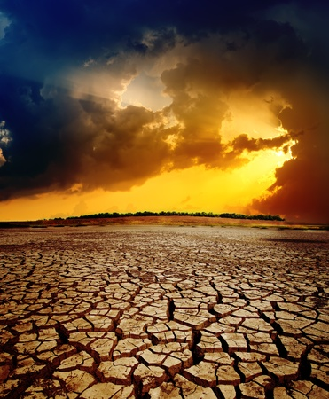 cracked earth: dramatic sunset over dry cracked earth