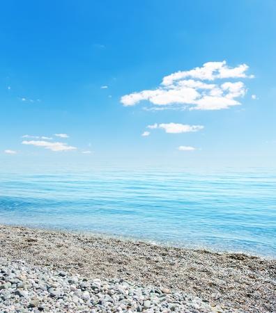 white pebble: stones on beach, sea and blue sky. Crimea, Ukraine