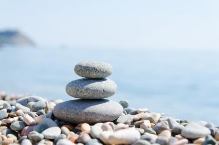 stack of zen stones near sea photo