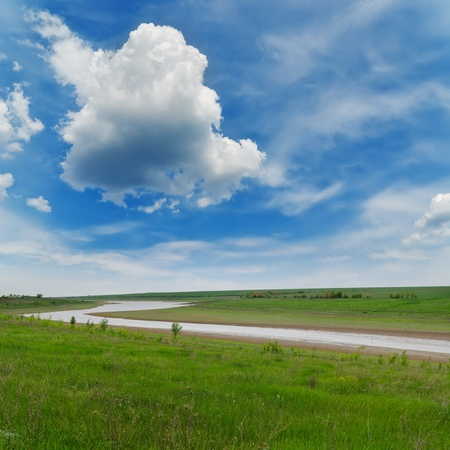 river in green grass under cloudy sky Stock Photo - 13768491