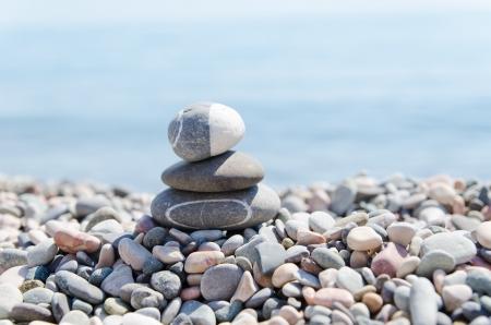 stack of zen stones on beach photo