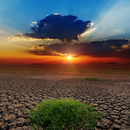 dramatic sunset over barren earth photo