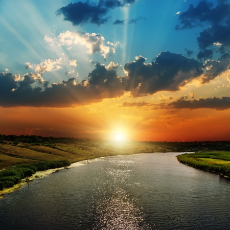 rays of sun: sunset over river