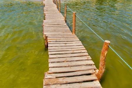 bridge over water: wooden bridge over water