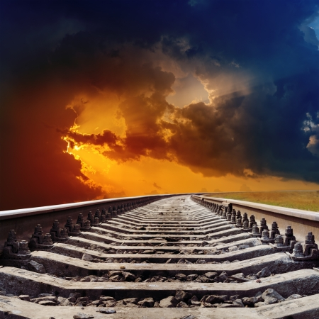 railway track: railroad goes to dramatic sunset