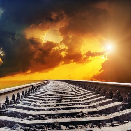 railway track: dramatic sunset over railroad