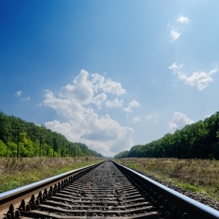 railroad to horizon in green landscape photo