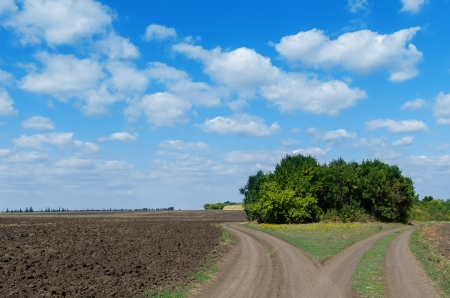 two rural road and cloudy sky Stock Photo - 15907614