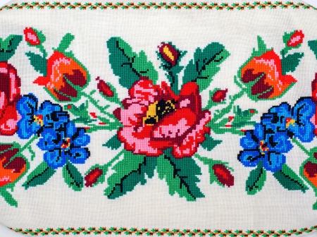 needlecraft: embroidered good by cross-stitch pattern. ukrainian ethnic ornament