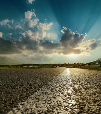 long road: asphalt road closeup to sunset Stock Photo