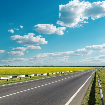 roadway: asphalt road under cloudy sky Stock Photo