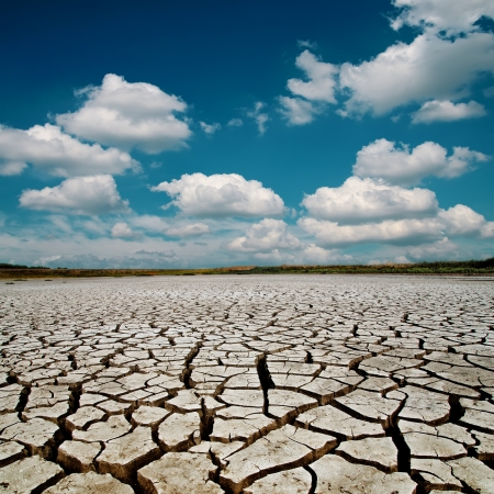 warming: global warming. dramatic sky over cracked earth