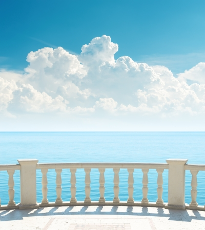 balustrade: balcony near sea and clouds over it