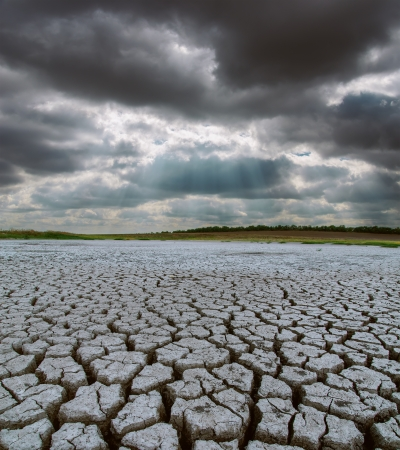 drought land under dramatic sky photo