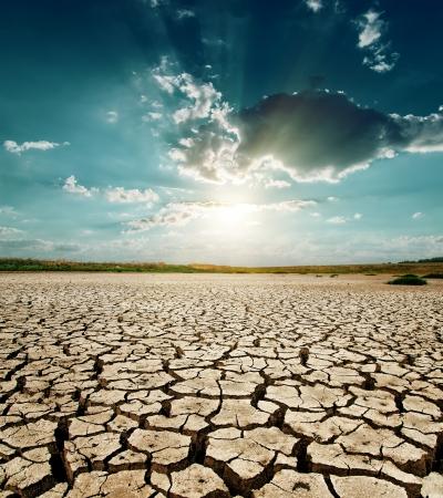 land: dramatic sunset over drought land