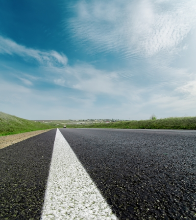 asphalt road closeup to cloudy horizon