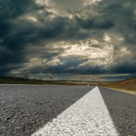 dramatic sky over asphalt road photo