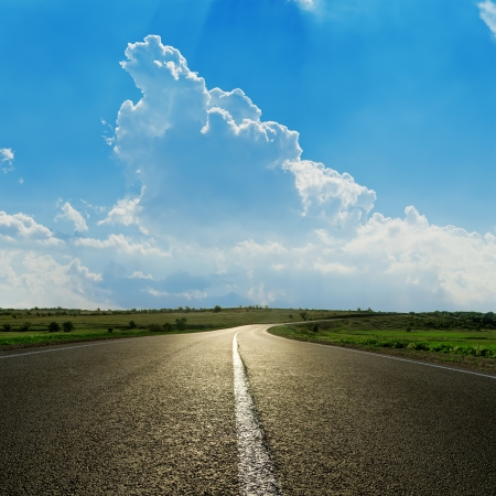 asphalt road closeup under cloudy blue sky Stock Photo - 17755175