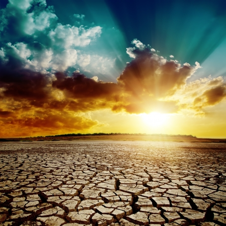 yellow earth: global warming. dramatic sunset over cracked earth