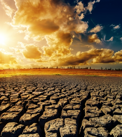 horizon over land: dramatic sunset over drought earth Stock Photo